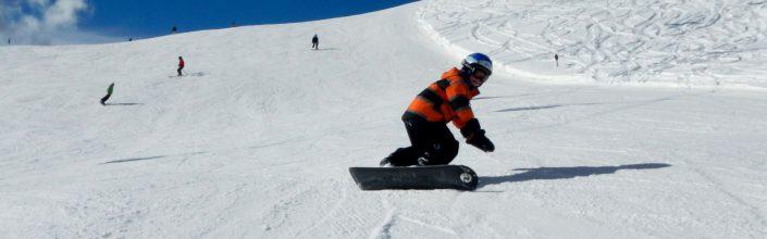 Snowboard fahren im Winterurlaub